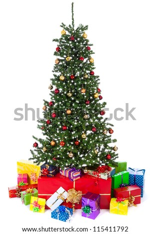 decorated christmas tree on white background with gifts - stock photo