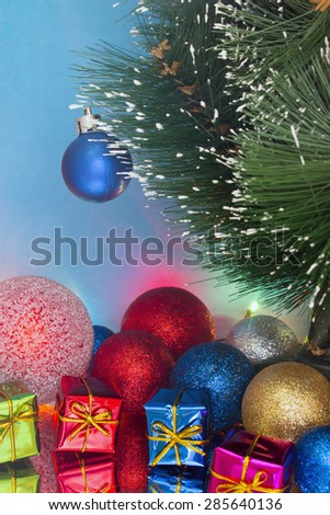 decorated Christmas tree with gifts and garlands - stock photo