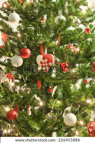 Decorated christmas tree with lights and ornaments - stock photo