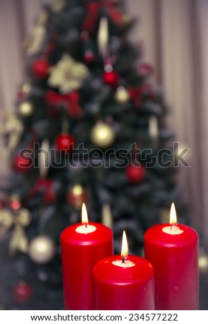 Decorated christmas tree with three candles - stock photo