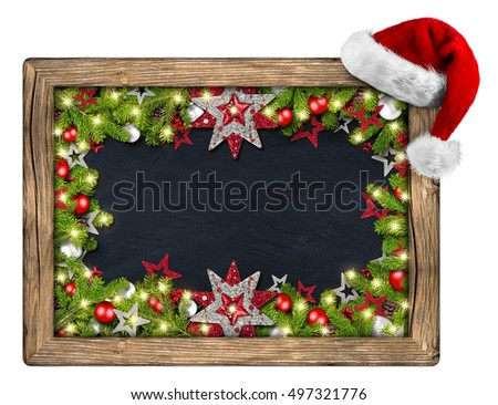 decorated christmas xmas blackboard chalkboard with wood frame santa hat fir branches christmas decoration red silver