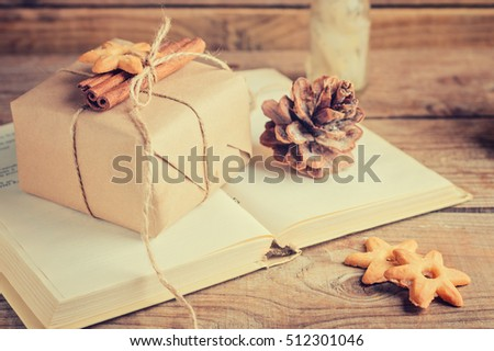 decorated cookies and cinnamon gift book. the rustic style. toned image