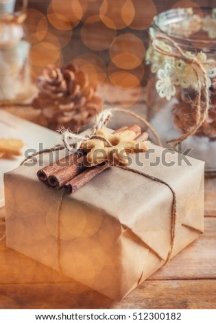 decorated cookies and cinnamon present. rustic style. bokeh effect, toned image