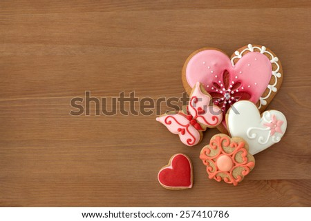 Decorated cookies with different shapes on wooden table - stock photo