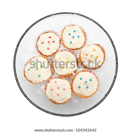 decorated cupcakes on a glass plate - stock photo