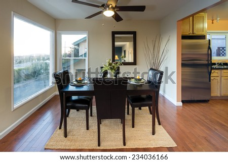 Decorated Dining Room Area with great bay view and glimpse into kitchen.  - stock photo