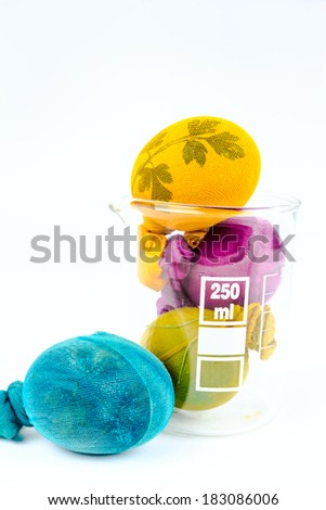 Decorated Easter eggs in a lab glass, new technologies in old customs  - stock photo