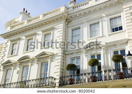 Decorated entrances of large houses in London's wealthy neighbourhood Notting Hill. - stock photo