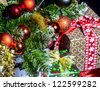 Decorated gift box under the Christmas tree - stock photo