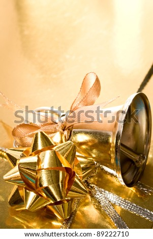Decorated gift box with a handbell - stock photo