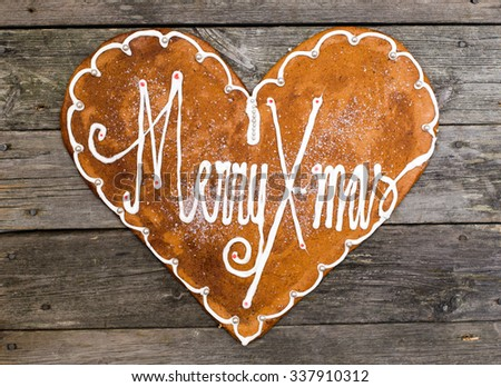 decorated gingerbread heart with text Merry Christmas - stock photo