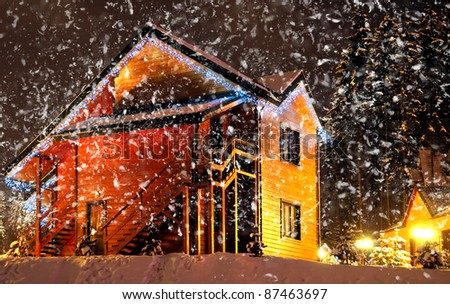 Decorated house with christmas lights - stock photo