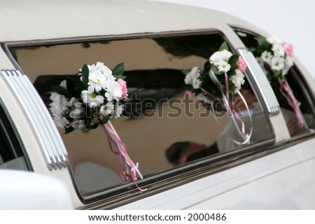 Decorated limousine on the wedding day - stock photo