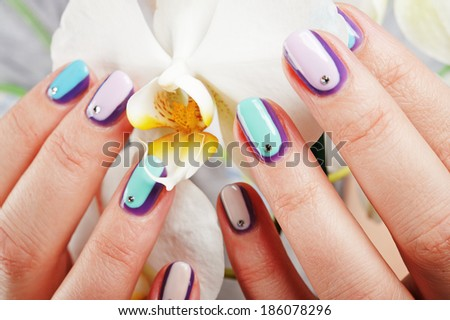 decorated nails / Nails decorated with lacquer hybrid - stock photo