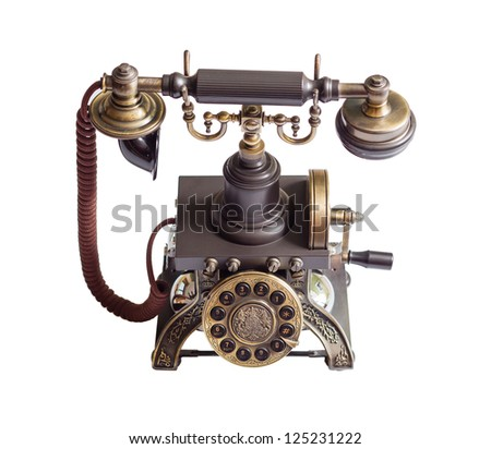 Decorated retro vintage metal telephone isolated on white background