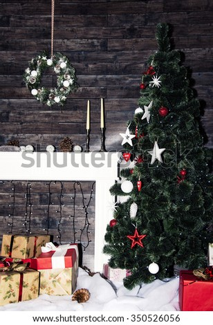 Decorated room with Christmas tree with presents