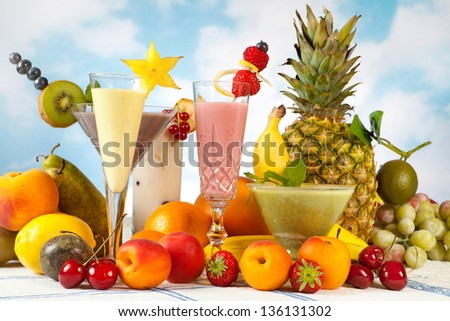 Decorated smoothies and an abundance of summer fruits - stock photo
