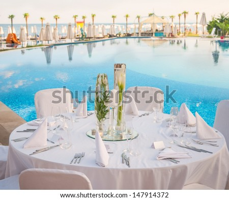 Decorated table for a wedding reception at beach resort - stock photo