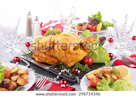 decorated table with roasted chicken