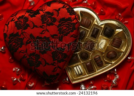 Decorated Valentine heart with assorted chocolate candies - stock photo