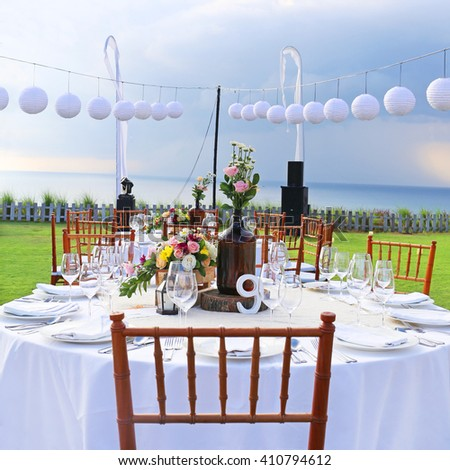 Decorated wedding table at reception beach resort - stock photo