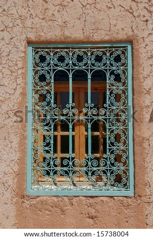 decorated window in alto atlas morocco - stock photo