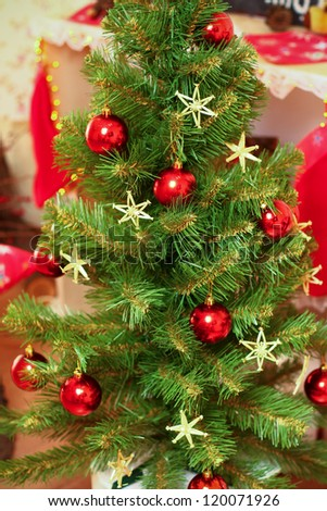 Decorated with red balls and stars Christmas and New Year tree