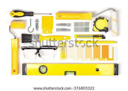 decorating and house renovation tools and accessories on white background top view. flat lay composition in yellow colors - stock photo