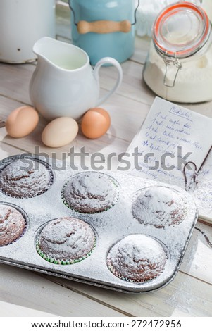 Decorating delicious muffins with caster sugar - stock photo