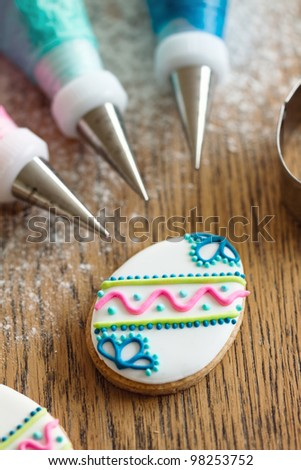 Decorating Easter cookies - stock photo