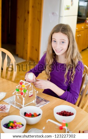 decorating gingerbread houses - stock photo