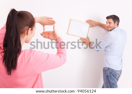decorating home putting frame - stock photo