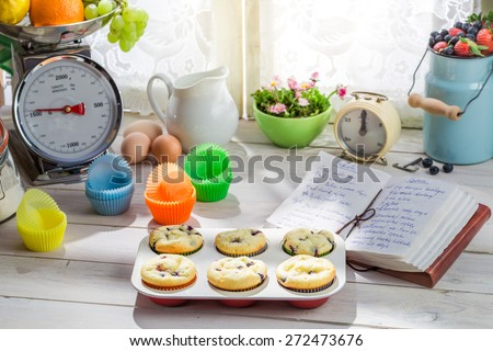 Decorating tasty cupcakes with cream and decoration - stock photo