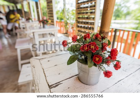 Decoration flower on the table in coffee shop ,Thailand - stock photo