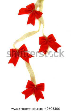 Decoration, gold ribbon with red bow. Useful for festive backgrounds and borders - stock photo