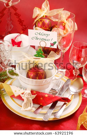 decoration of christmas table with angel in  white and red colors - stock photo