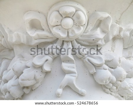 Decoration of stone carving pattern above a garden vase detail