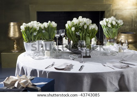 Decoration of the dining table for Valentine's Day. White tulip.