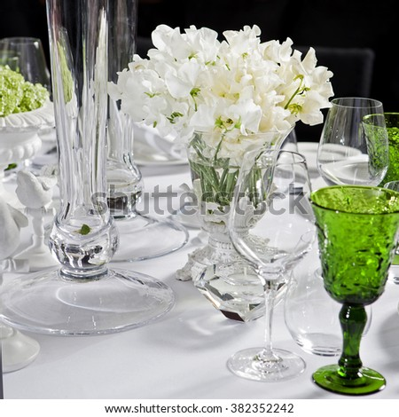 decoration of wedding table. bouquet of white flowers of sweet pea