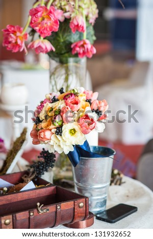 decoration of wedding table.floral arrangements and decorations.arrangement of hydrangeas and roses in vases - stock photo