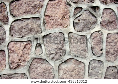 decoration on a wall made of natural stone close up - stock photo