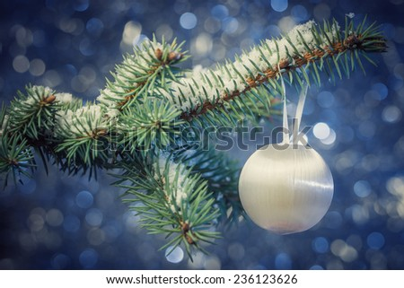 Decoration on Christmas tree on abstract background - stock photo