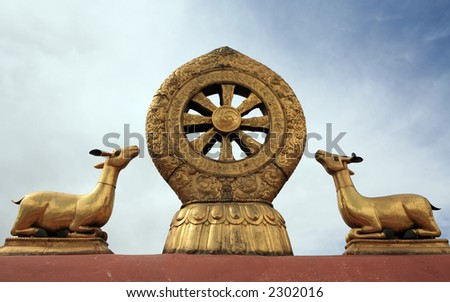 Decoration on the roof of the Jokhang temple in Lhasa (Tibet). - stock photo