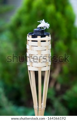 Decoration tiki oil torche for lighting or insect repellent. - stock photo