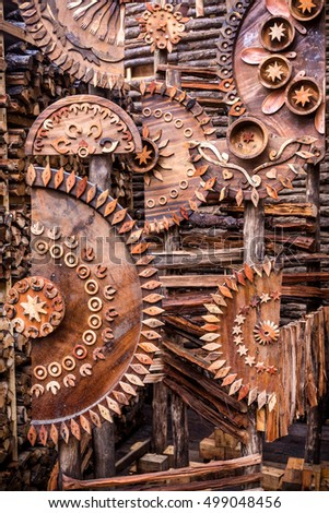 Decorations depicting mechanical gears using common household wooden objects and firewood