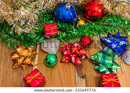 Decorations for Christmas and New Year on a wooden floor. Used for the background.