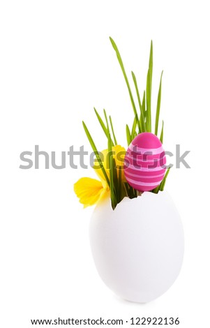 Decorations for Easter with painted eggs, isolated on white - stock photo