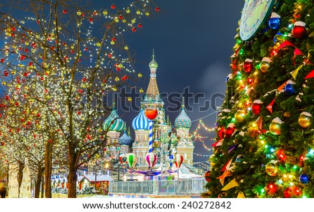 Decorations for New Year and holidays. Christmas balls on tree branches near to St. Basil's Cathedral on Red square in Moscow - stock photo