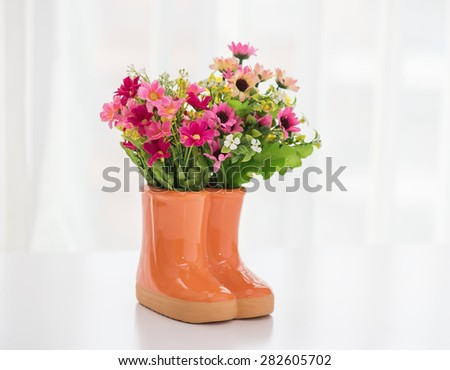 decorations for the garden. boots with flowers - stock photo