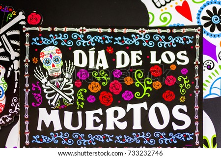 Decorations for traditional Mexican holiday Day of the Dead on a black background.